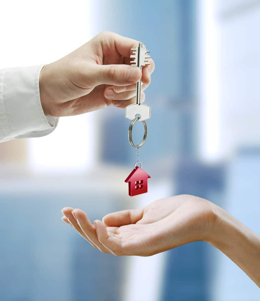 quick home sale concept- hands exchanging keys